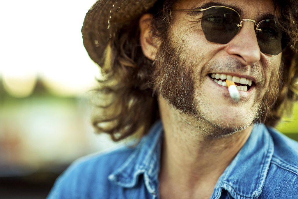 "Joaquin Phoenix stars as Larry ""Doc"" Sportello, a private investigator with a pot-smoking habit, in Inherent Vice, Paul Thomas Anderson's film adaptation of the novel by Thomas Pynchon."