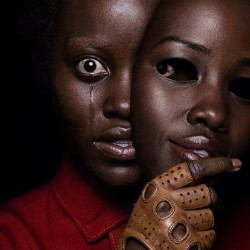 unsettling-new-poster-for-jordan-peeles-us-features-lupita-nyongo-holding-a-mask-of-her-own-face-social
